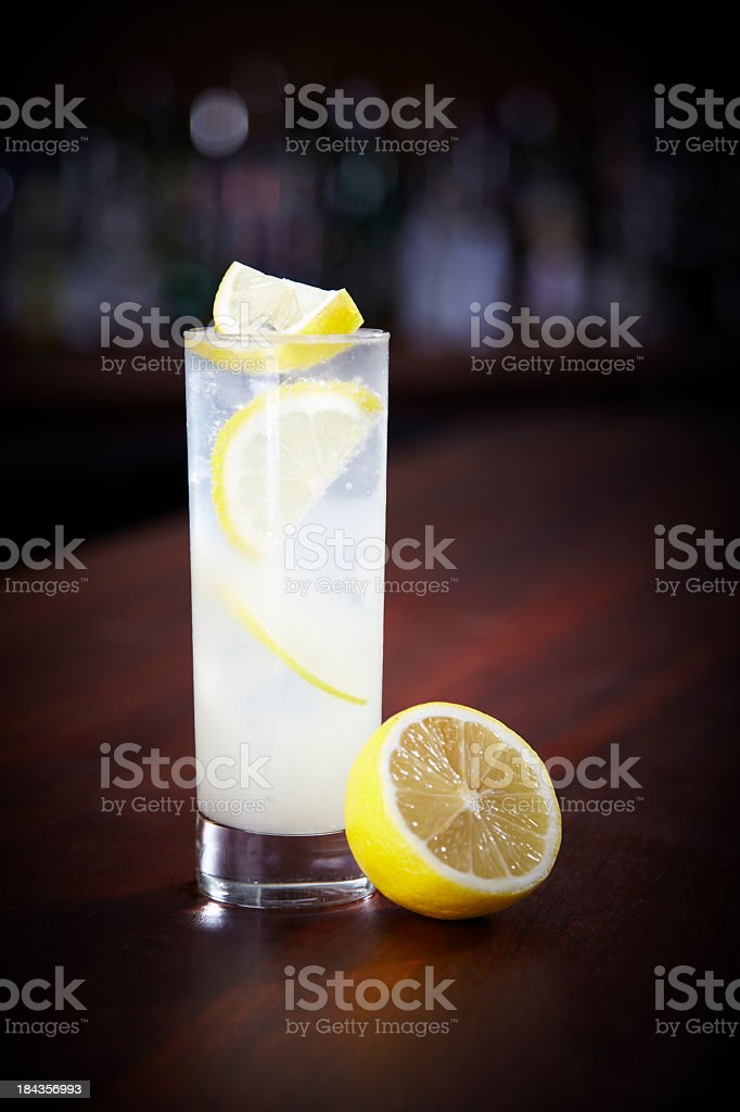 Tall glass of Tom Collins with lemon garnish stock photo