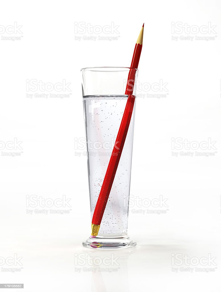 Tall glass of water, with a red pencil inside. stock photo