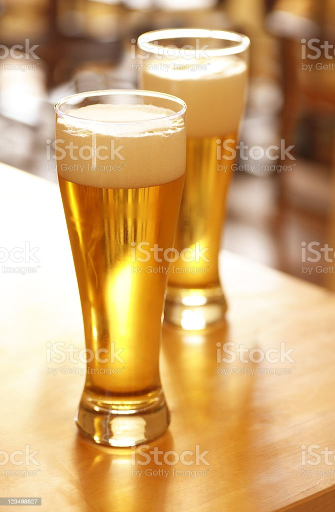 Tall Glasses of Beer in a Restaurant royalty-free stock photo