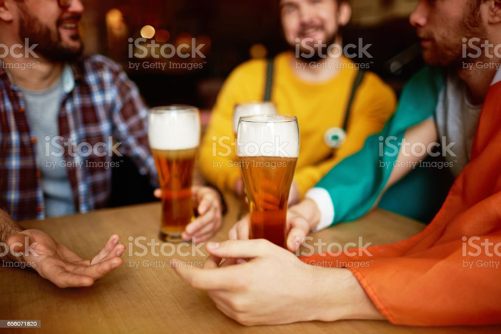 Tall Glasses of Craft Beer in Pub stock photo