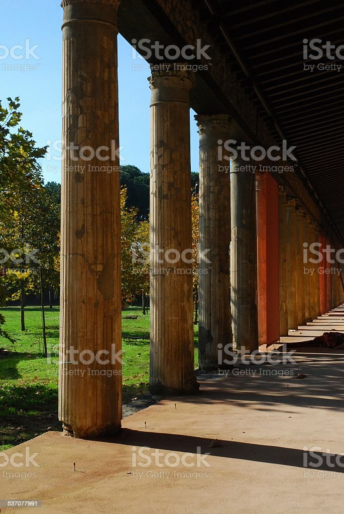 Tall, Golden Columns in the Ruins at Pompeii royalty-free stock photo