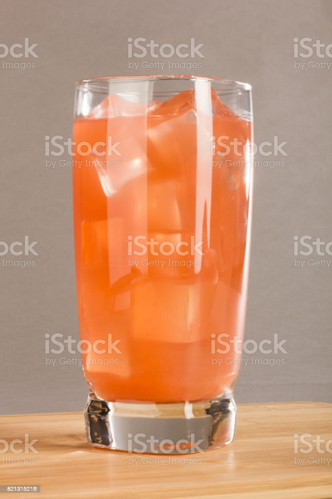 Tall Icy Glass of Grapefruit Juice stock photo