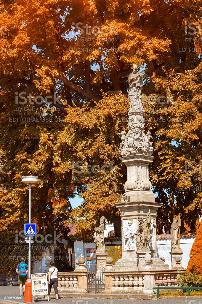 Tall monument at crucifixion in ossuary in Sedlec Kostnice stock photo