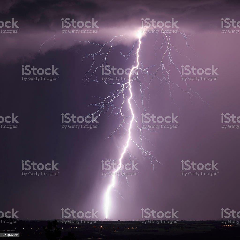 Tall negative cloud to ground lightning stock photo