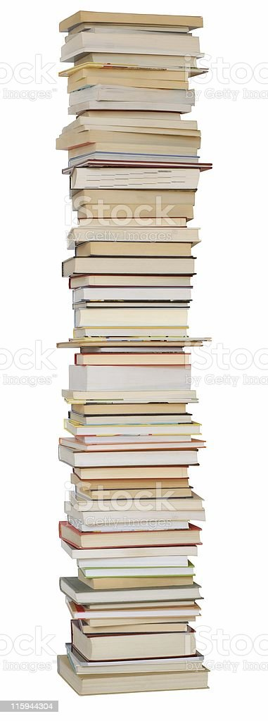 Tall pile of books against white background stock photo