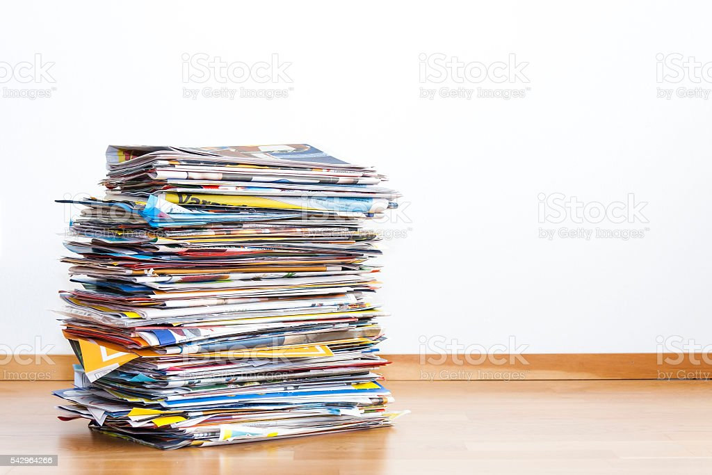 Tall pile of newspaper advertisements stock photo