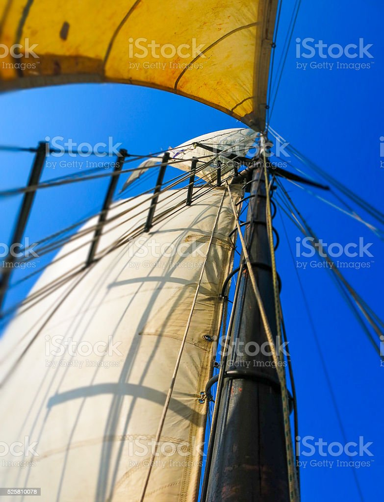 Tall Sail Boat Mast and Ladder in the Wind stock photo