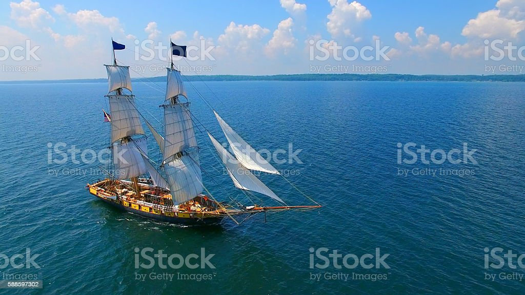 Tall sailing ship sailing off to distant shores stock photo