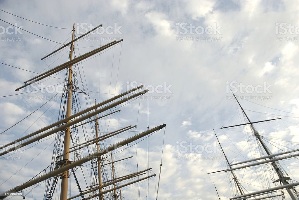 Tall Ship Masts Bright Clouds stock photo
