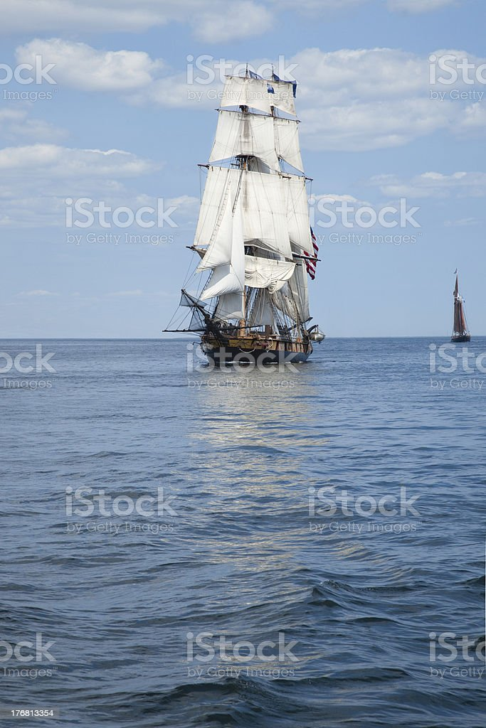 Tall ship on blue waters stock photo