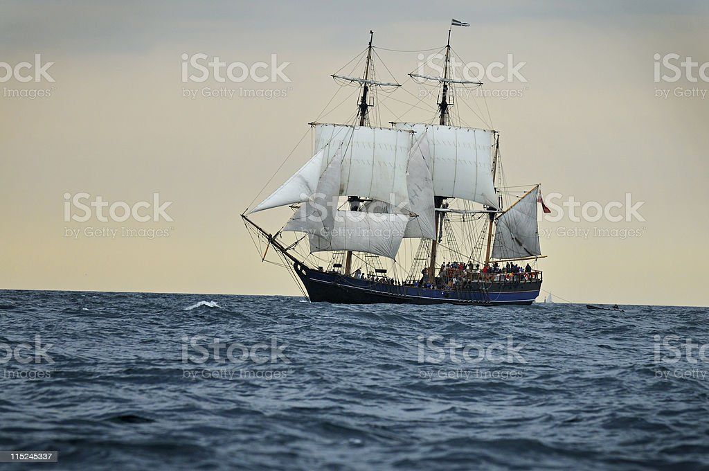 Tall ship sailing into sunset, Cornwall - UK royalty-free stock photo