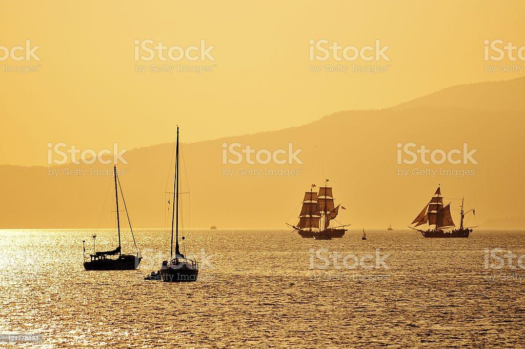 tall ships at sunset stock photo