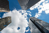 Tall skyscrapers set against blue skies in the city