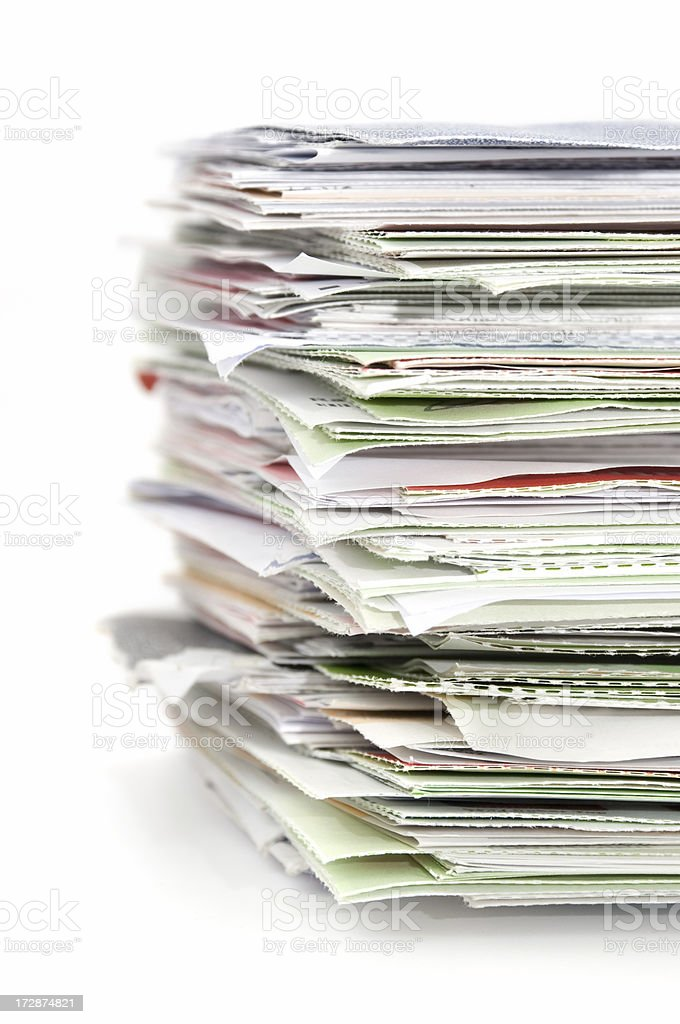 Tall stack of mail and paper against a white background. royalty-free stock photo