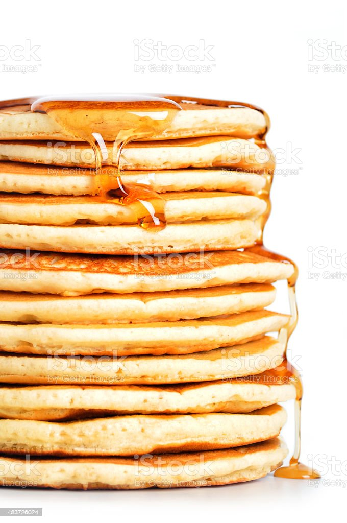 Tall Stack of Pancakes Sits on a White Background stock photo