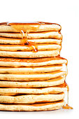 Tall Stack of Pancakes Sits on a White Background
