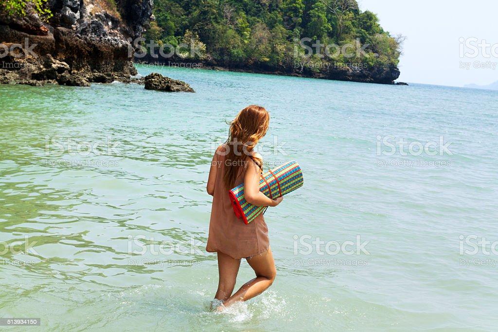 Tall thai girl walking into sea stock photo
