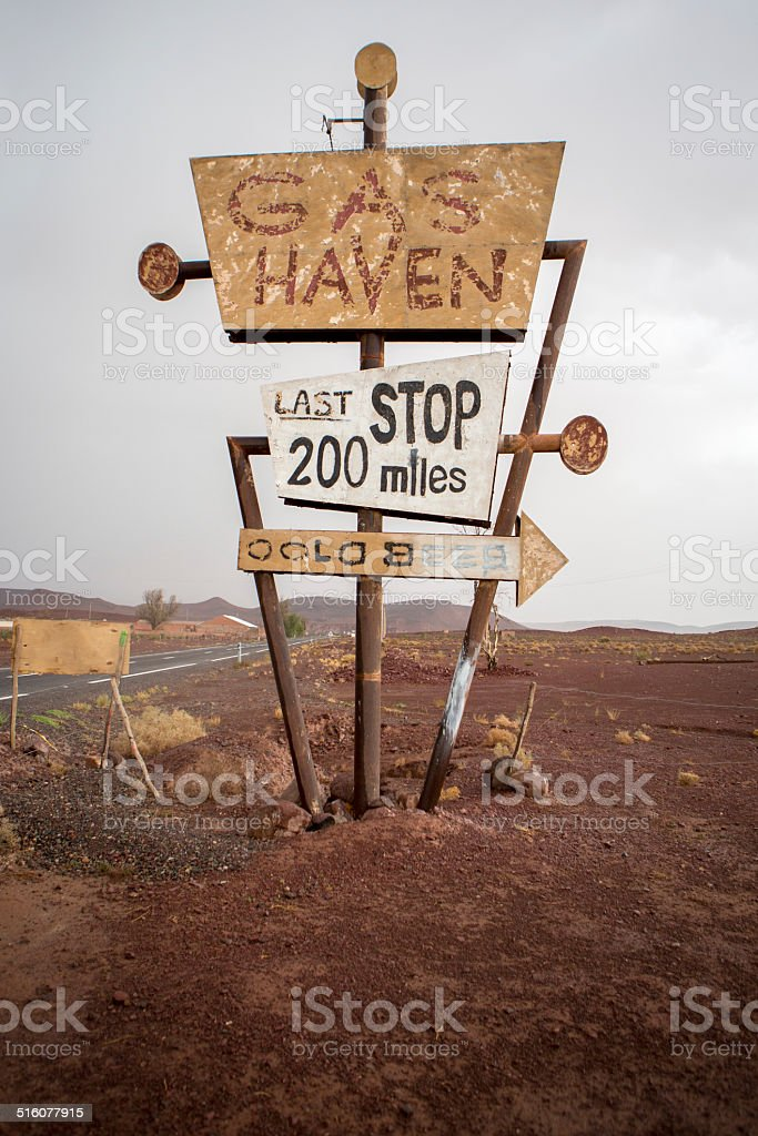 Tall vintage gas sign standing in the desert stock photo