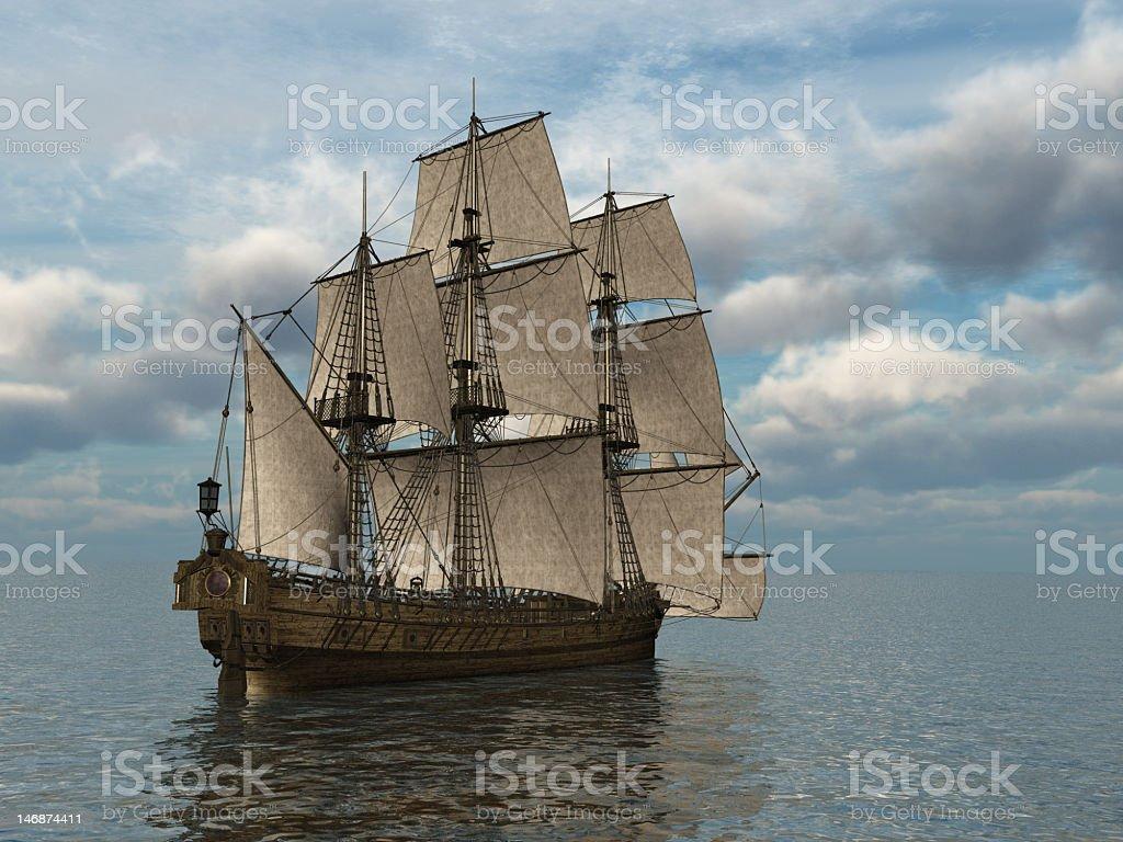 Tall wooden sail ship floating at sea stock photo