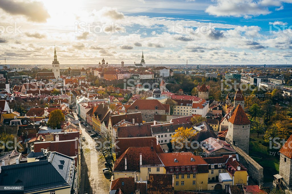 Tallinn city from above view against sun and cloudscape, Estonia stock photo