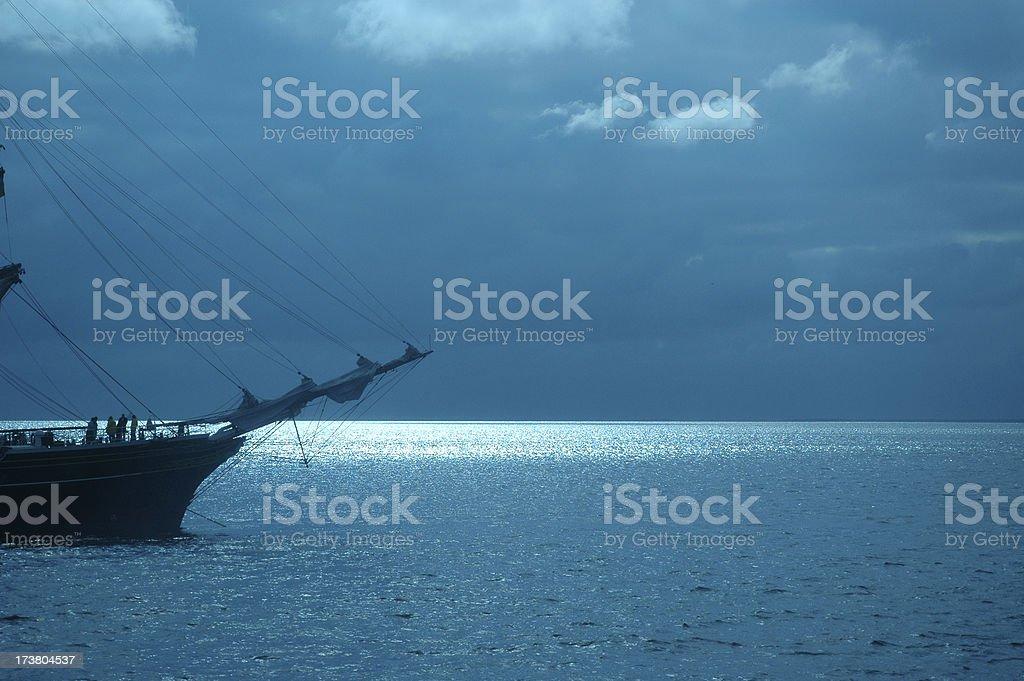 Tallship at night with moonlight reflecting 3 royalty-free stock photo