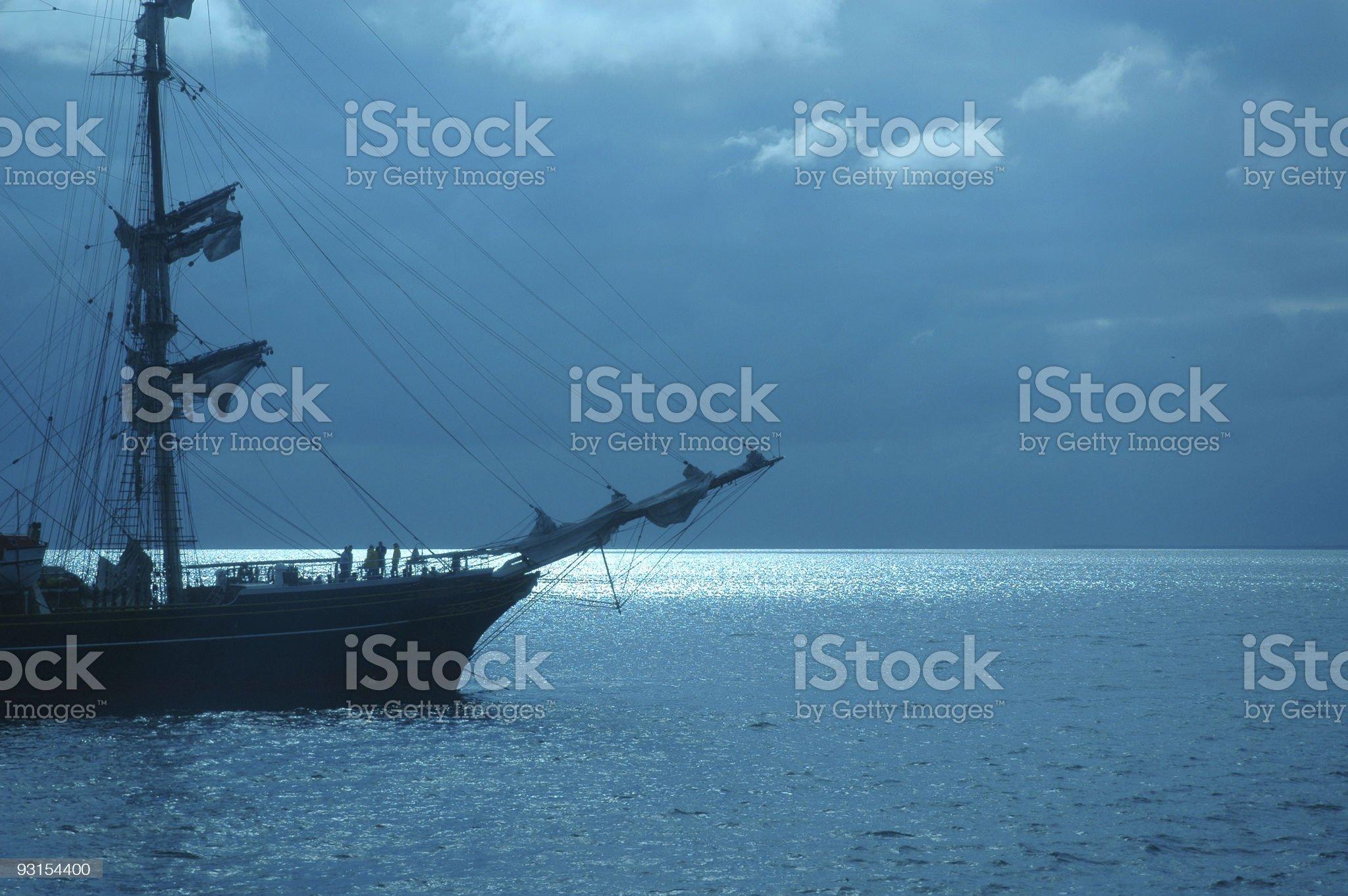 Tallship at night with moonlight reflecting royalty-free stock photo