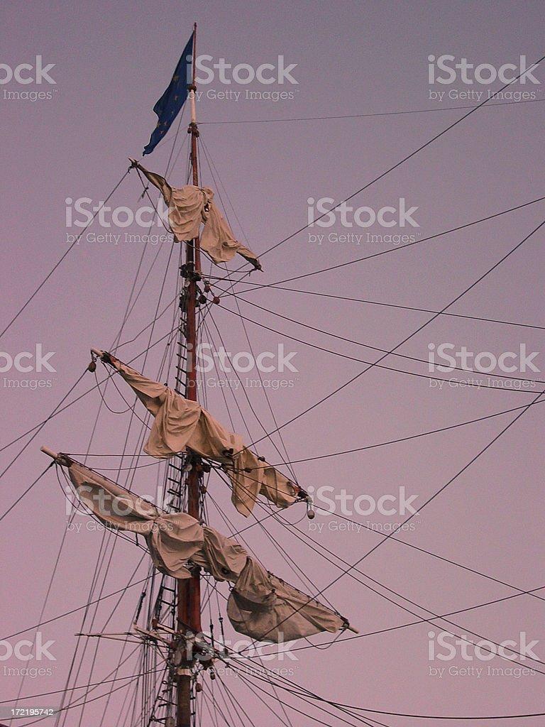 Tallship mast at sunset stock photo