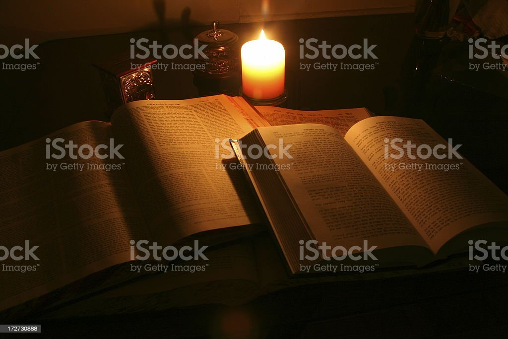 Talmud at candle light stock photo