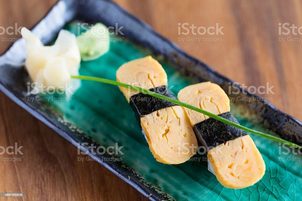 Tamago (egg) nigiri sushi stock photo