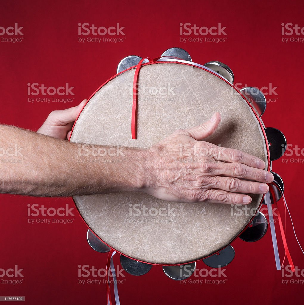 Tambourine Played On red royalty-free stock photo