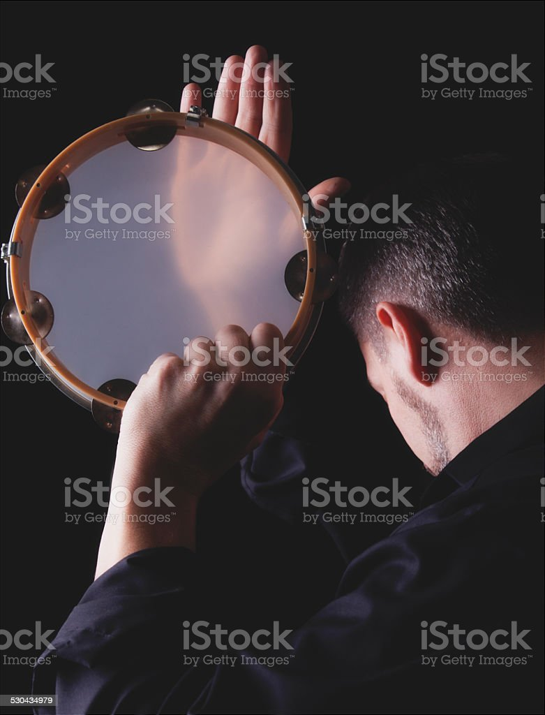 Tambourine Player stock photo