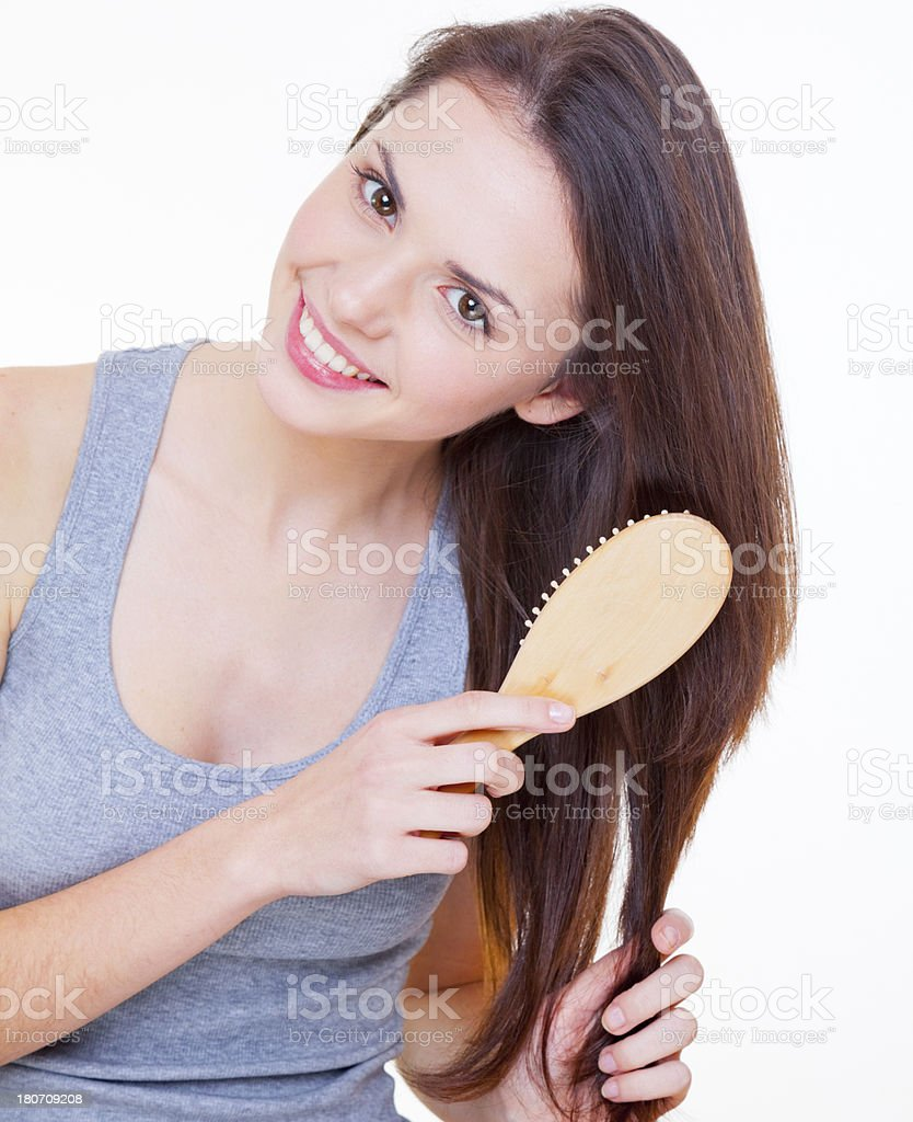 Taming her beautiful hair royalty-free stock photo