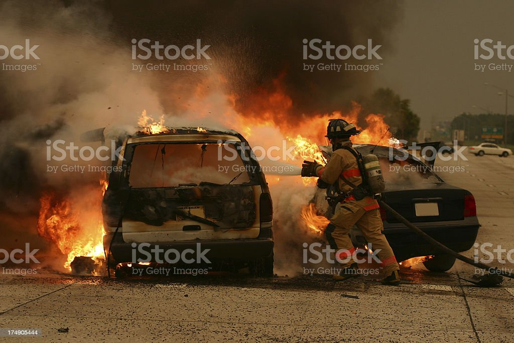 Tampa Firefighter puts out a car fire stock photo