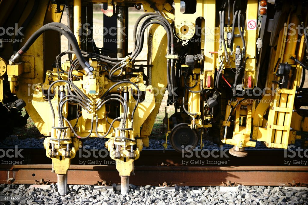 Tamping machine track construction stock photo