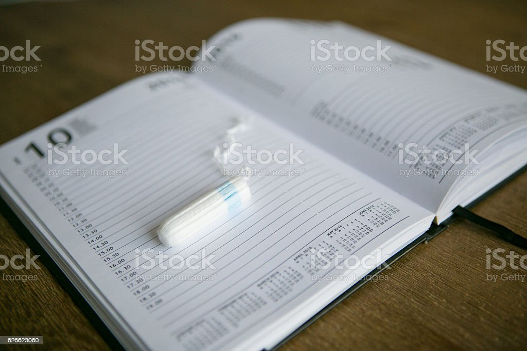 Tampon on a diary stock photo