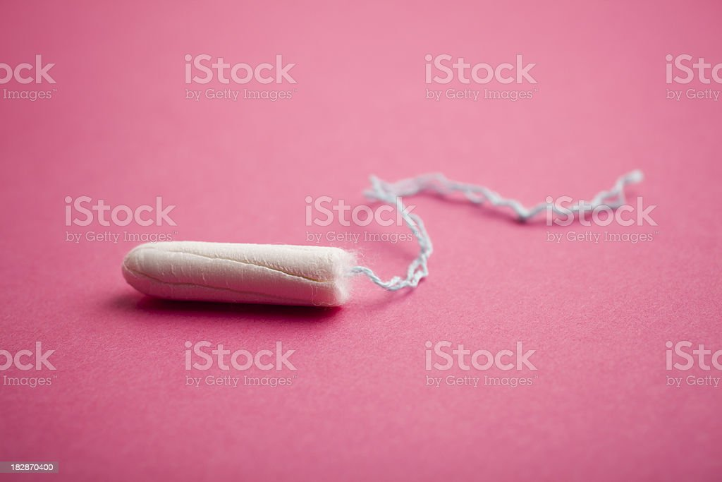 Tampon on pink background stock photo