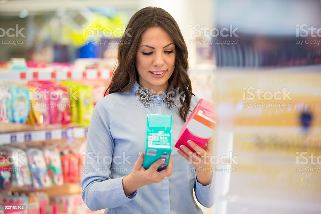 Tampon versus sanitary pad stock photo