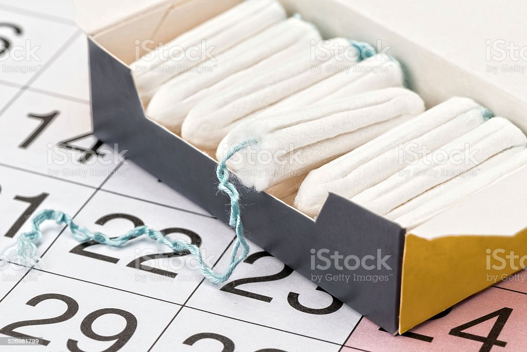 Tampons and a calendar stock photo