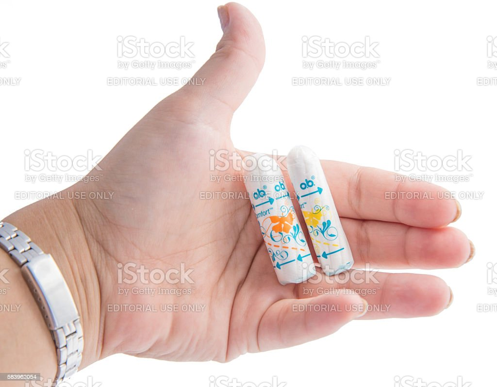 O.B. tampons on differend sizes in woman's hand stock photo