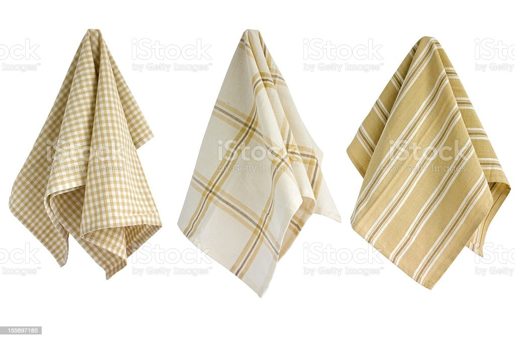 Tan and white kitchen towels hanging stock photo