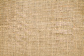 A tan burlap textile background can you be used for a sack