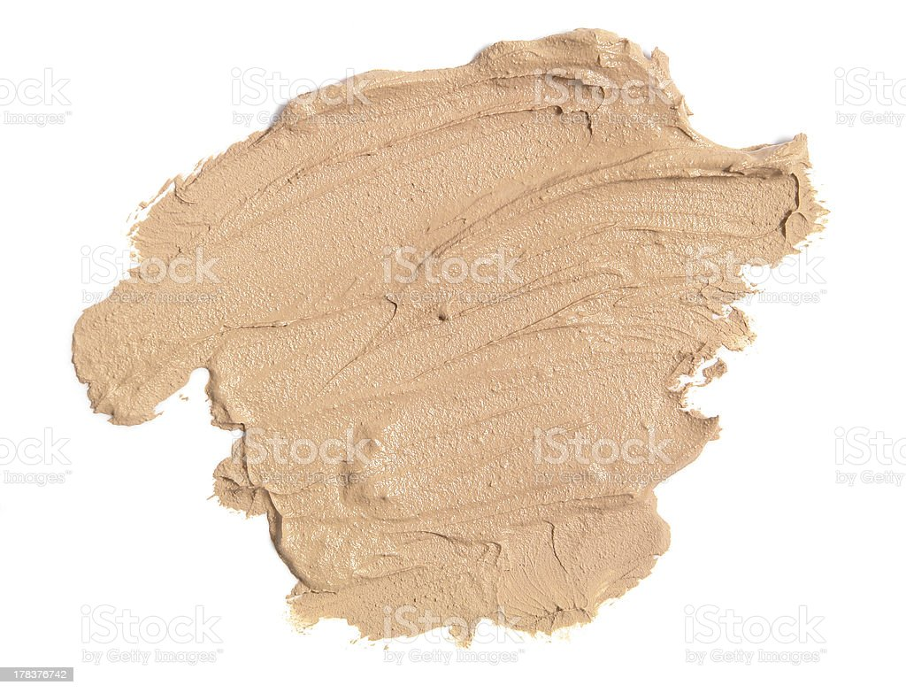 Tan face cream sample on a white background royalty-free stock photo