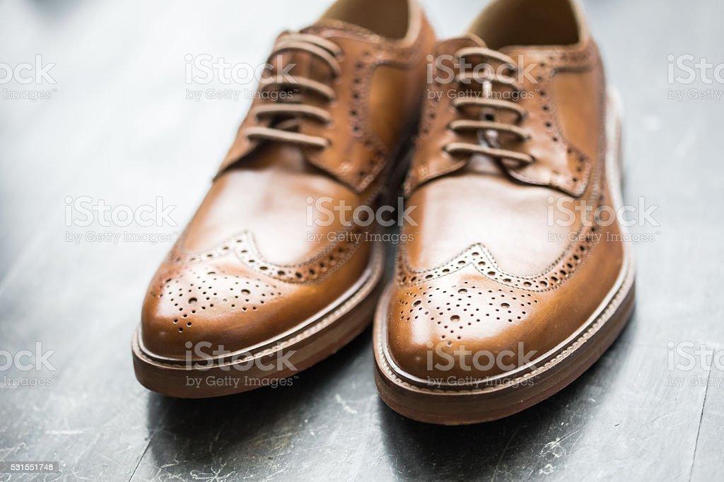 Tan Italian designer leather brogues stock photo