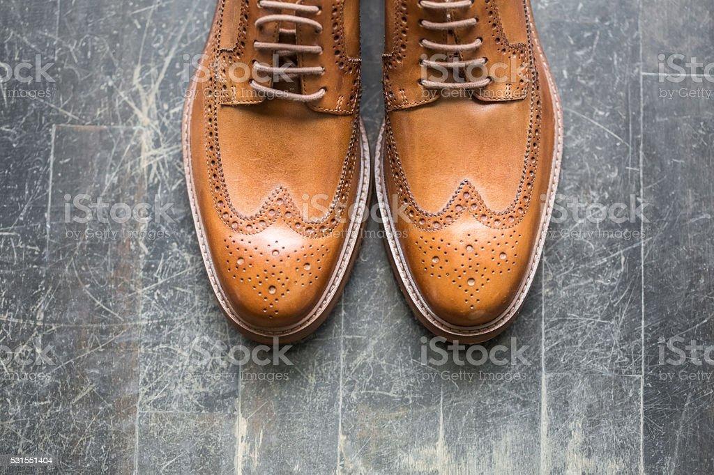 Tan Italian leather  designer brogues stock photo