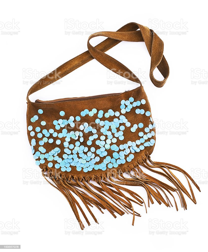 Tan leather bag with tassels and blue spots stock photo