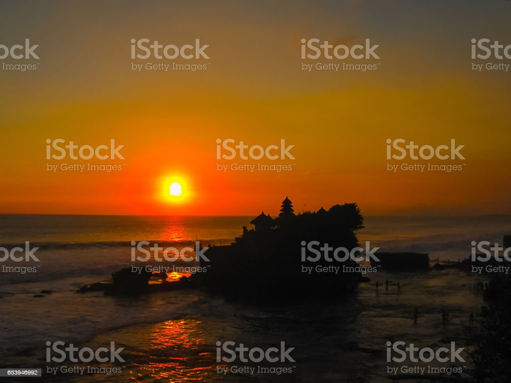 Tanah Lot and sea waves in golden sunset, Bali stock photo