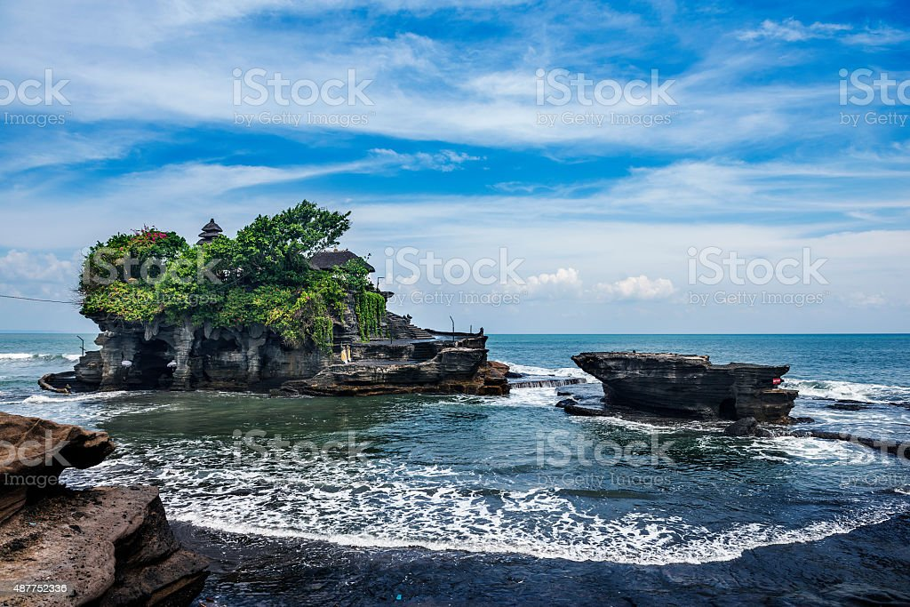 Tanah Lot is a rock formation off the Indonesian stock photo