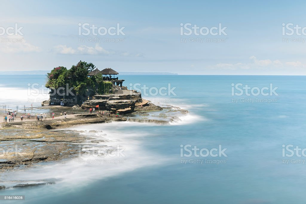 Tanah Lot temple in Bali in long exposure stock photo
