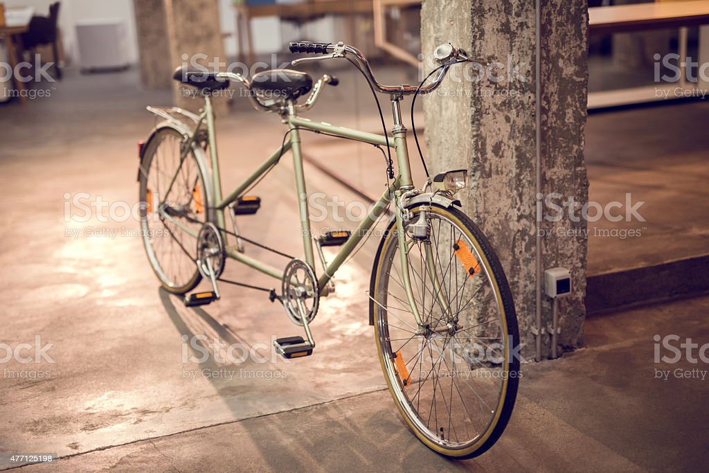 Tandem bicycle indoors. stock photo