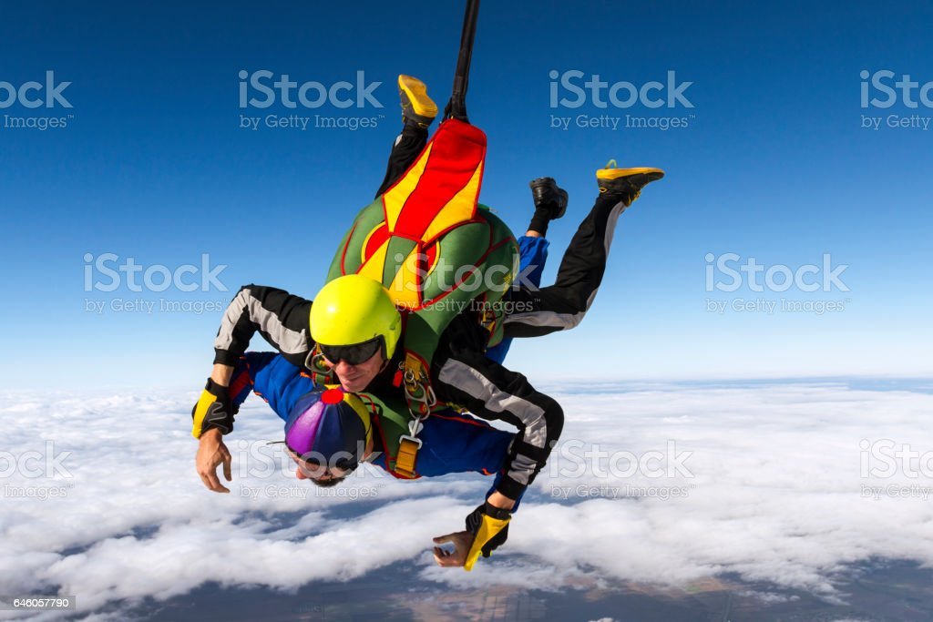Tandem jump. Flying in a free fall. stock photo